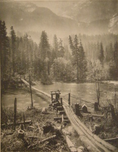 The_Loggers'_Bridge_Suspended_Over_the_Skykomish_1910